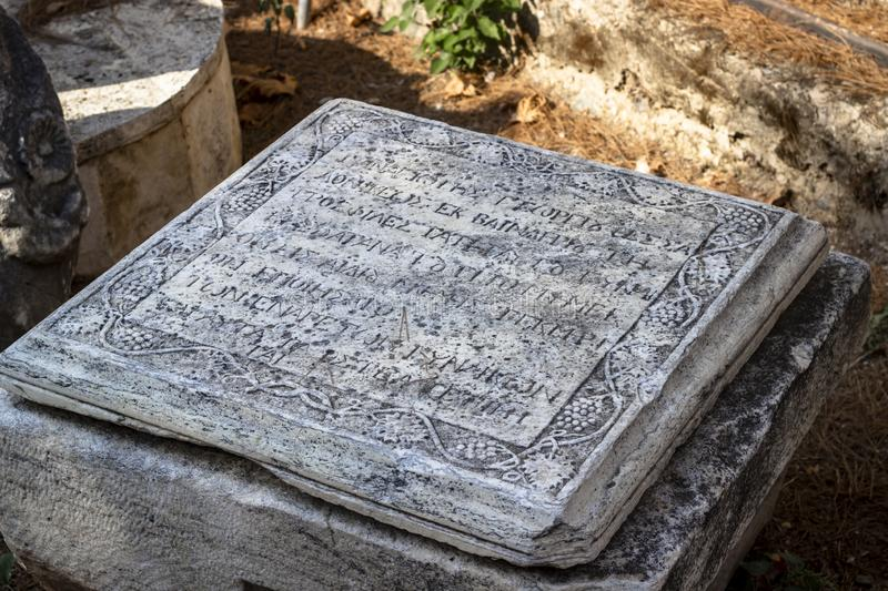 Perspective shoot of ancient Greek tabloid carved on stone. Photo has taken in Turkey royalty free stock photos
