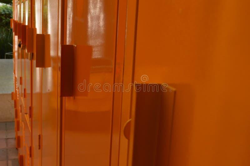 Close up of orange closed school lockers royalty free stock image