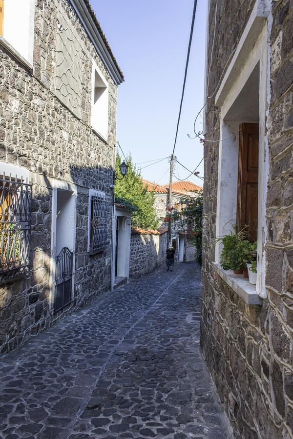 Perspective shot of old middle age design street with stone road at Lesvos, in Mytilene stock image