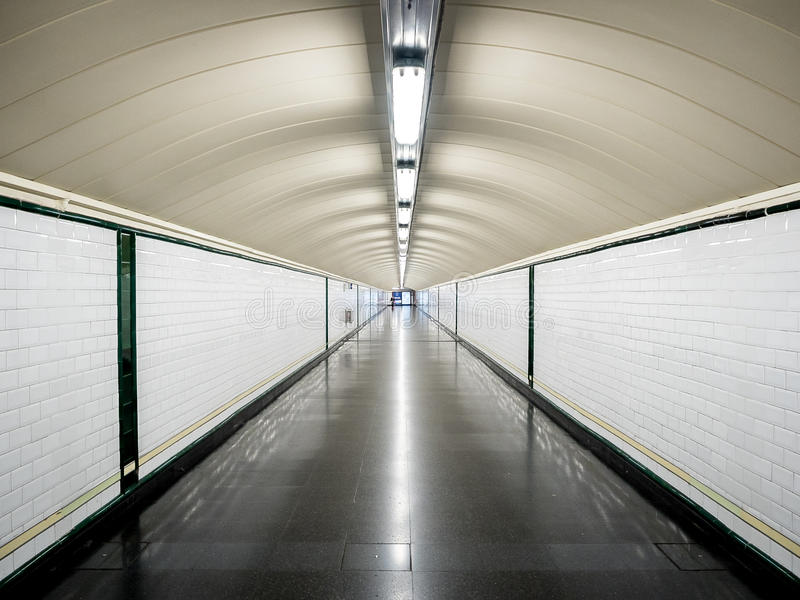 Perspective tunnel in the metro without people. Perspective tunnel in the metro empty with a persone in the background stock photography