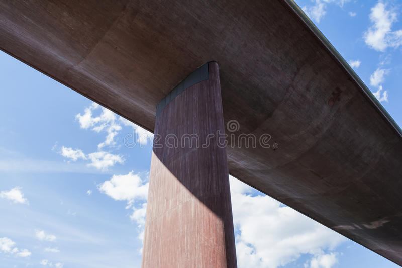 Perspective from under a huge, concrete bridge against summer sky royalty free stock photos