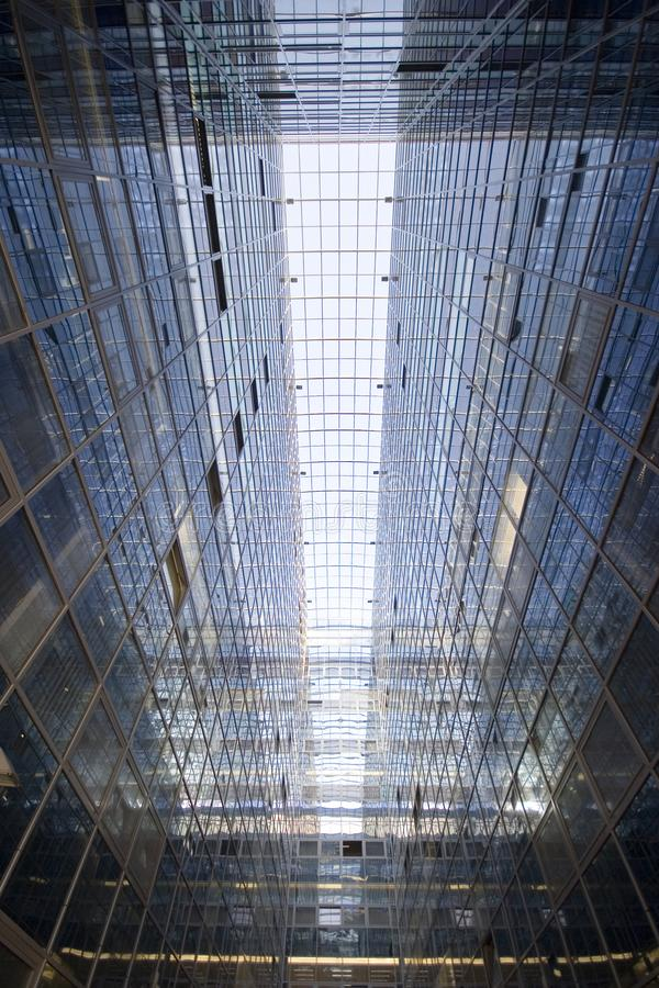 Perspective and underside angle abstract view to textured background of modern glass office building royalty free stock photography