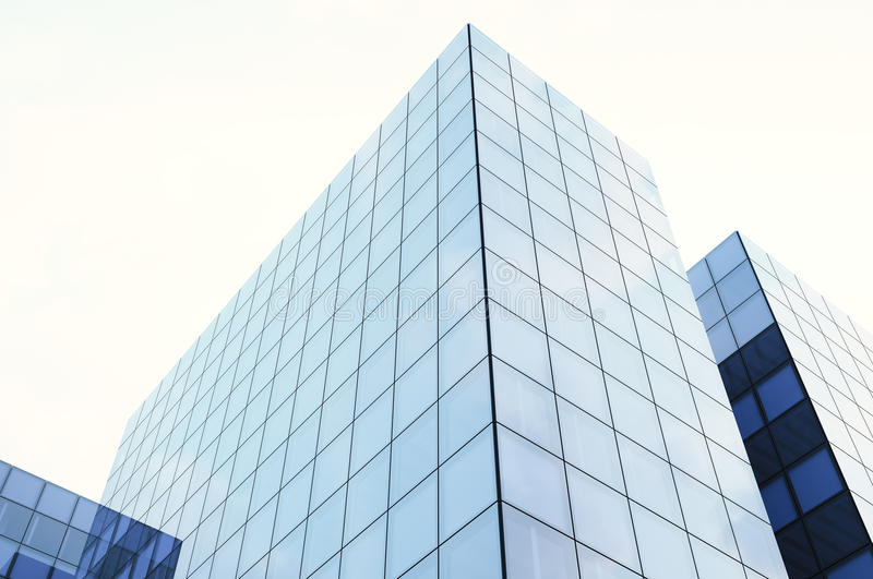 Perspective and underside angle view of modern glass blue building skyscrapers. Blue sky, horizontal mockup. 3d render royalty free stock image