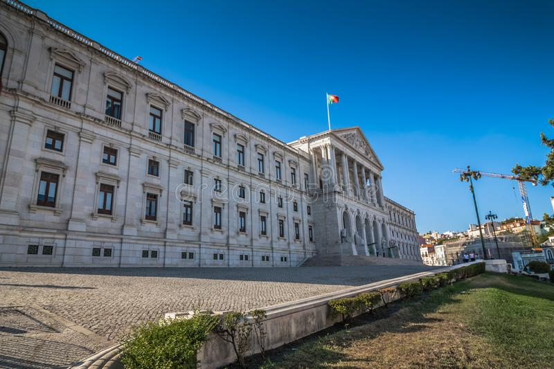 Perspective view of Assembly of the Republic building in Lisbon. White stone facade of monumental Portuguese parliament - Sao. Perspective view of Assembly of stock image