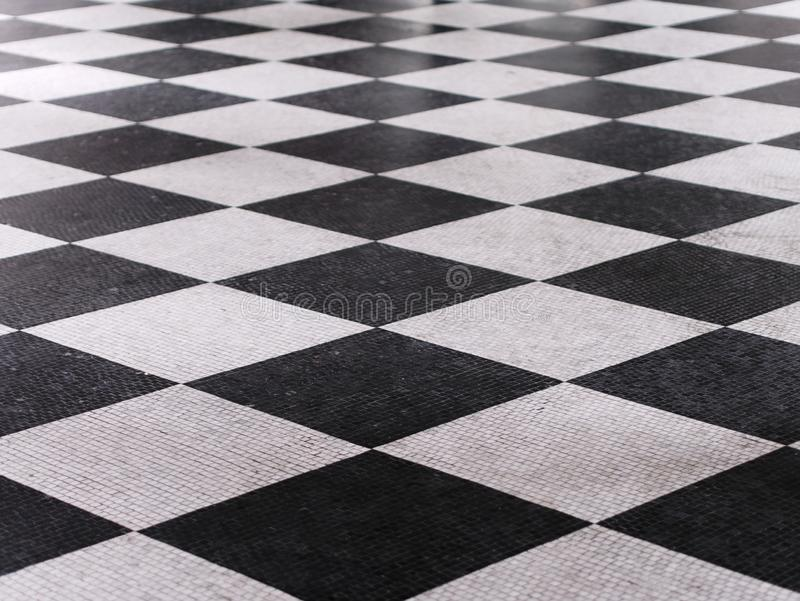 Black and white checkered marble floor pattern royalty free stock images