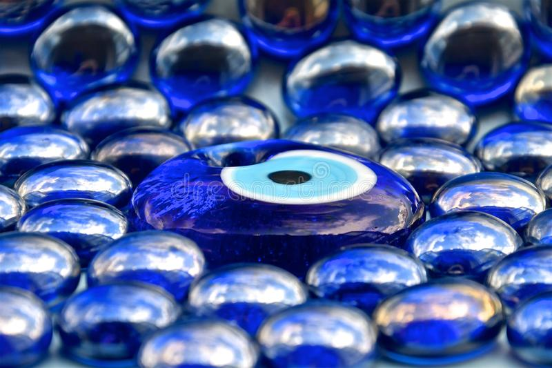 Perspective view of blue glass peacock bead stock images