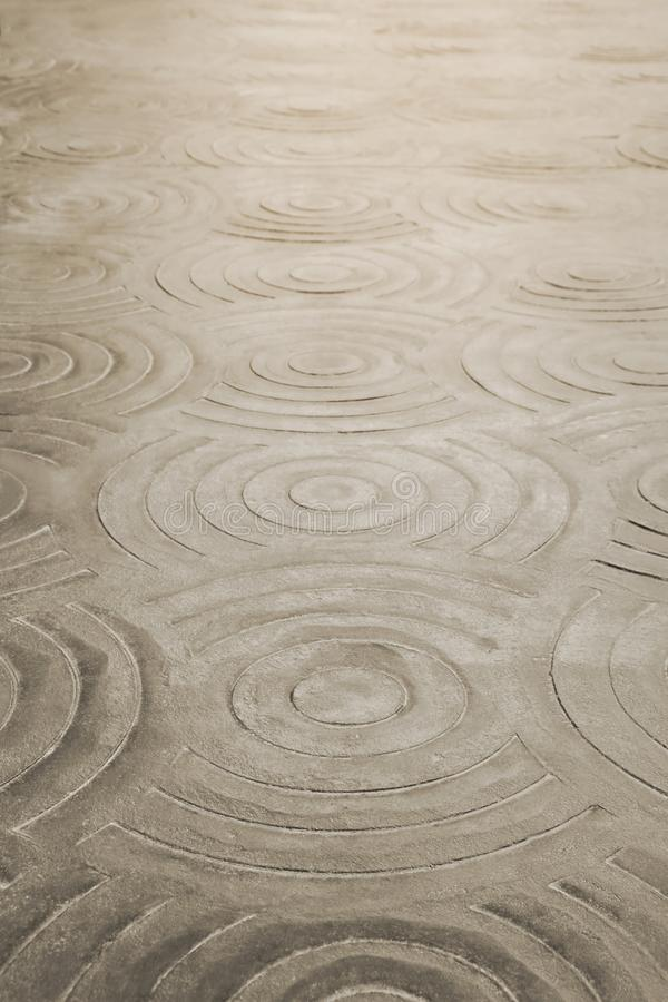 Perspective View of Circular Pattern Stamped Concrete Pavement royalty free stock photo
