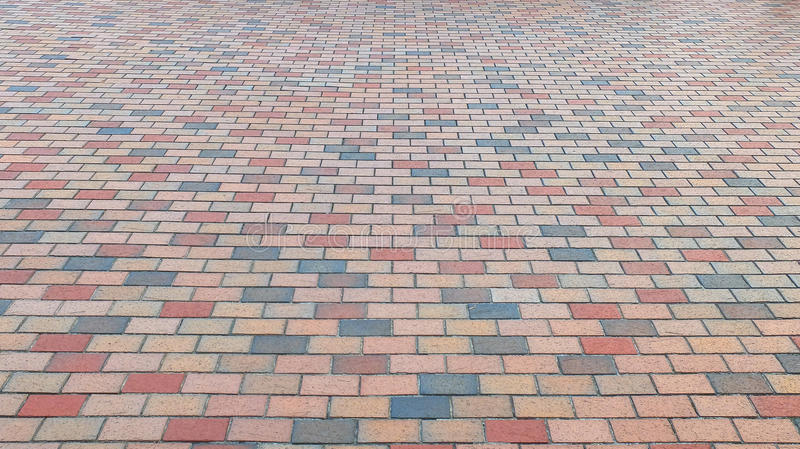 Perspective View of Colorful Brick Stone Street Road. Sidewalk, Pavement Texture Background stock image