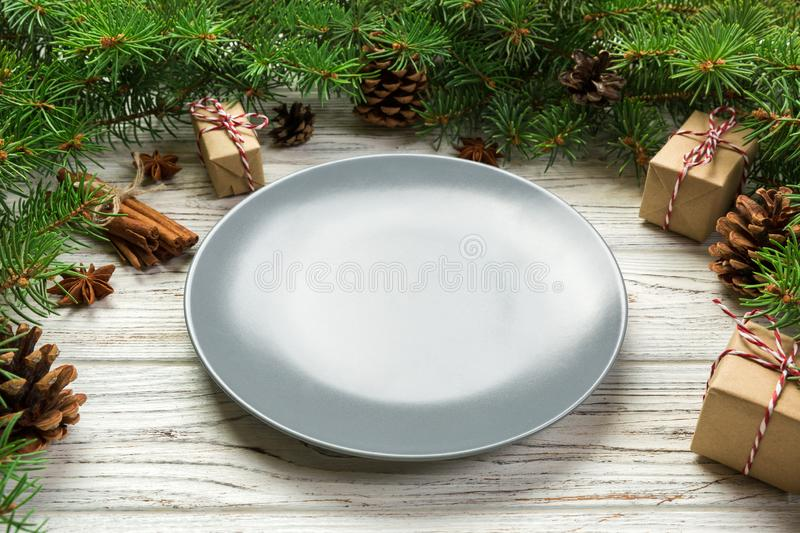 Perspective view. Empty plate round ceramic on wooden christmas background. holiday dinner dish concept with new year decor.  royalty free stock photos