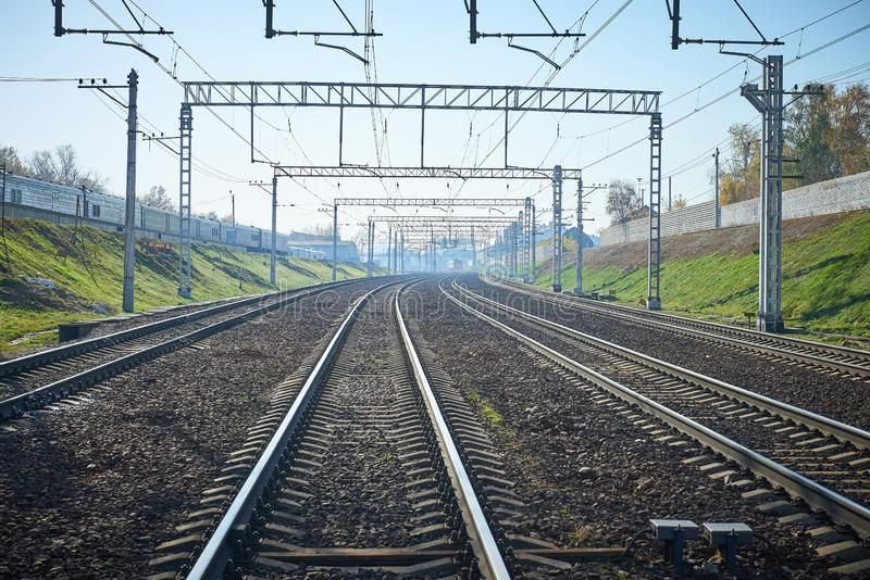 Perspective view on empty railway tracks for high speed trains and suburban trains and electric infrastructure equipment, wires, d. Evices. Empty rail road stock photo