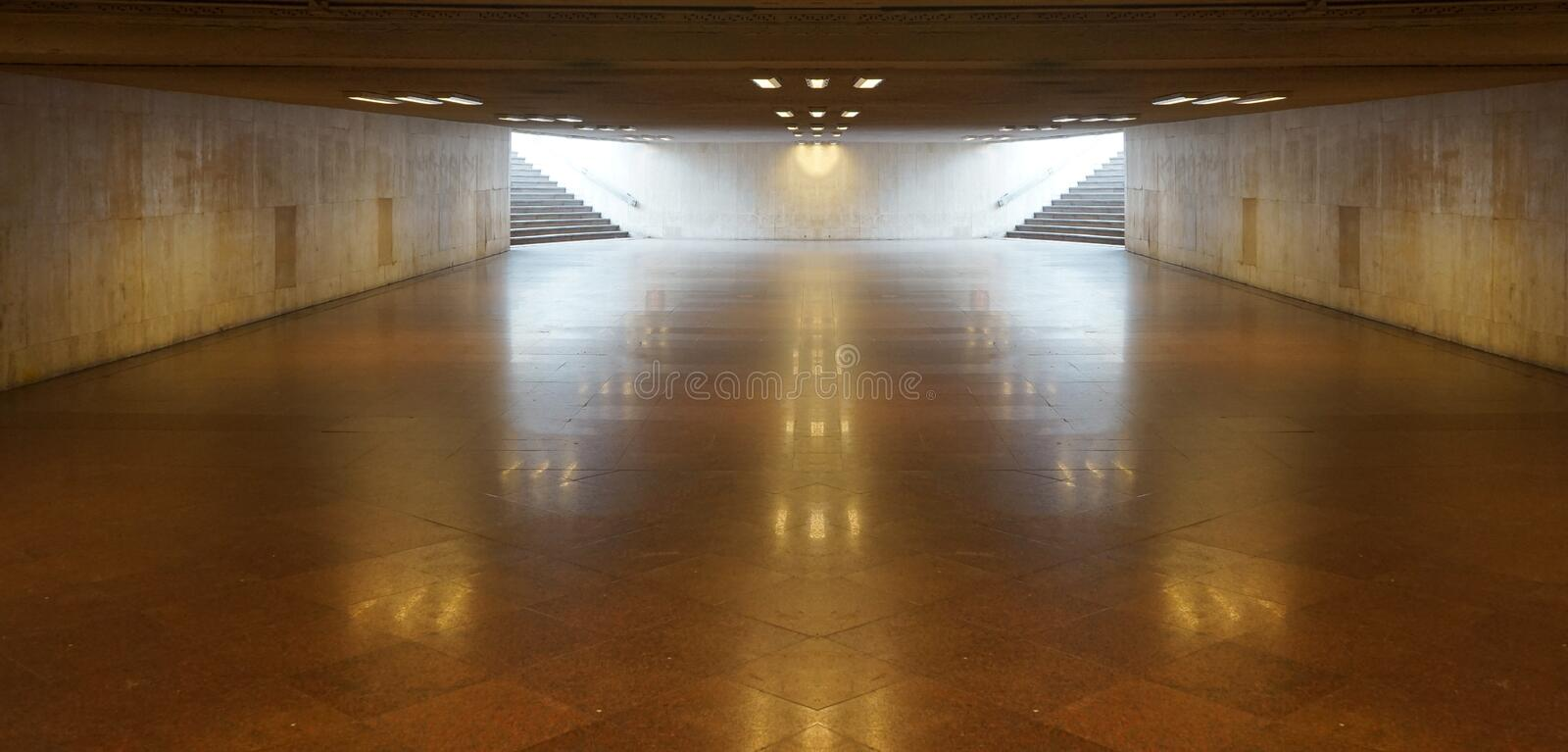 Perspective View of Empty Underground Tunnel Hallway, Pavement, Walkway in Vintage Design LED Light Ceiling Pattern. And Ground Flooring Square Brick Pattern stock photos
