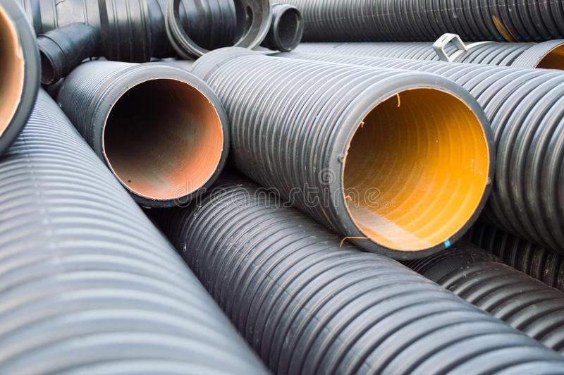 Perspective view of garnered black plastic substructure pipes stock images