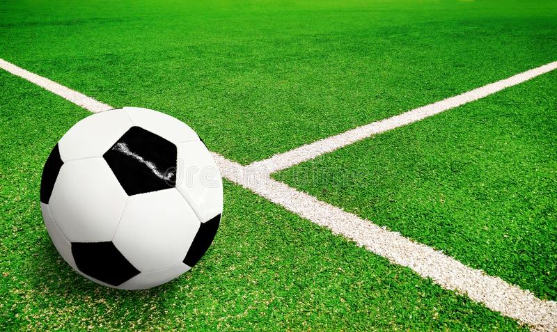 Green football pitch with soccer ball royalty free stock photos