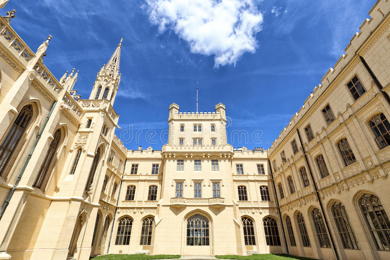Perspective view of Lednice castle court under deep blue sky royalty free stock image