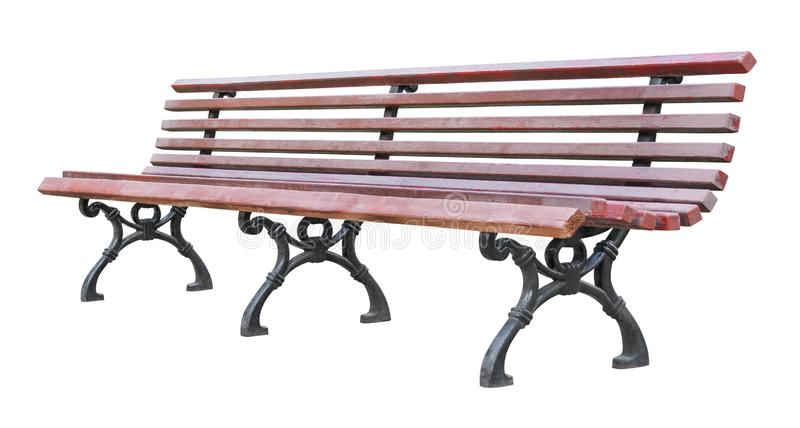 Perspective view on a length brown wooden bench with curved wrought legs, isolated on a white background stock image