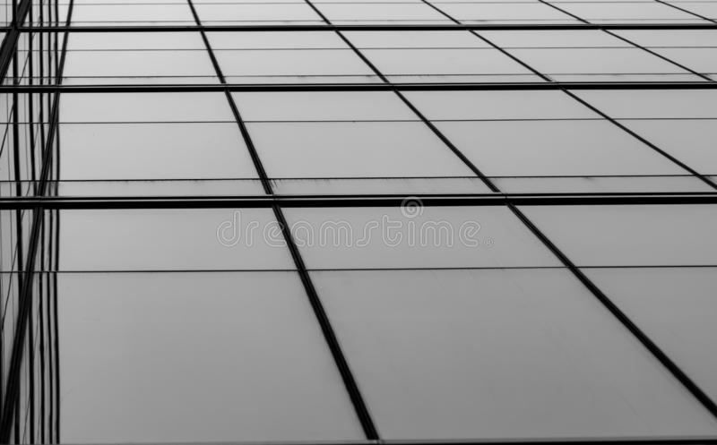 Perspective view of modern futuristic  glass building abstract background. Exterior of office glass building architecture. royalty free stock images