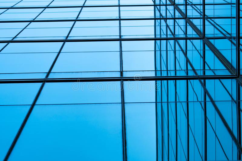Perspective view of modern futuristic glass building abstract background. Exterior of office glass building architecture. stock photography