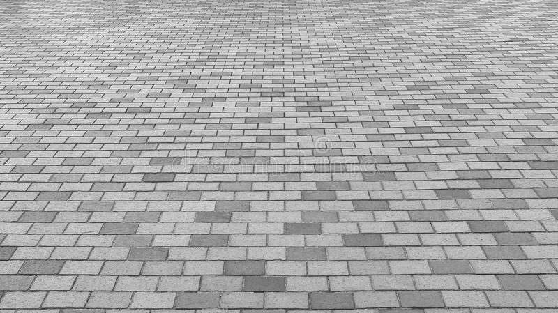 Perspective View of Monotone Gray Brick Stone Street Road. Sidewalk, Pavement Texture stock image