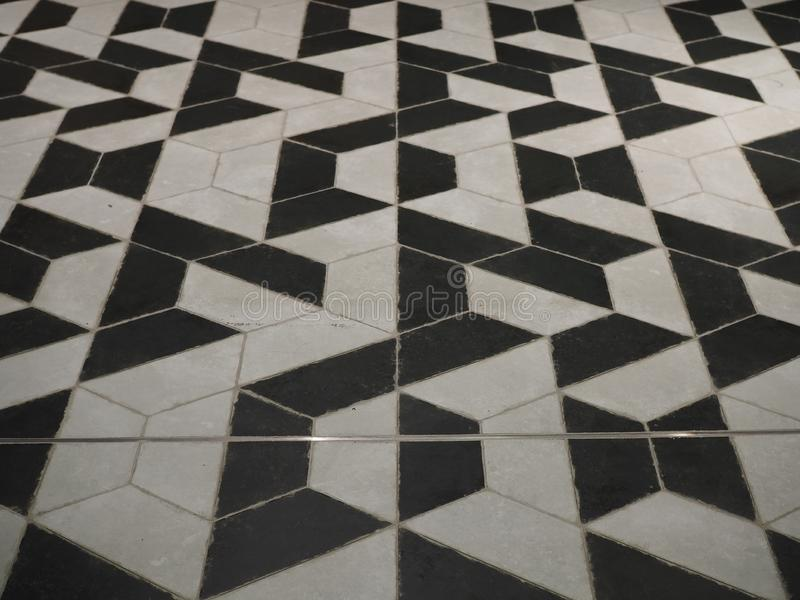 Perspective View of Real Black and White Tiles with Weird Pattern. At a Department Store in Thailand stock photos