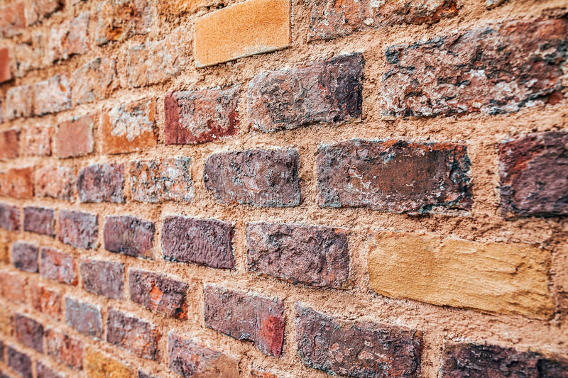 Perspective view of red grunge brick wall royalty free stock photo