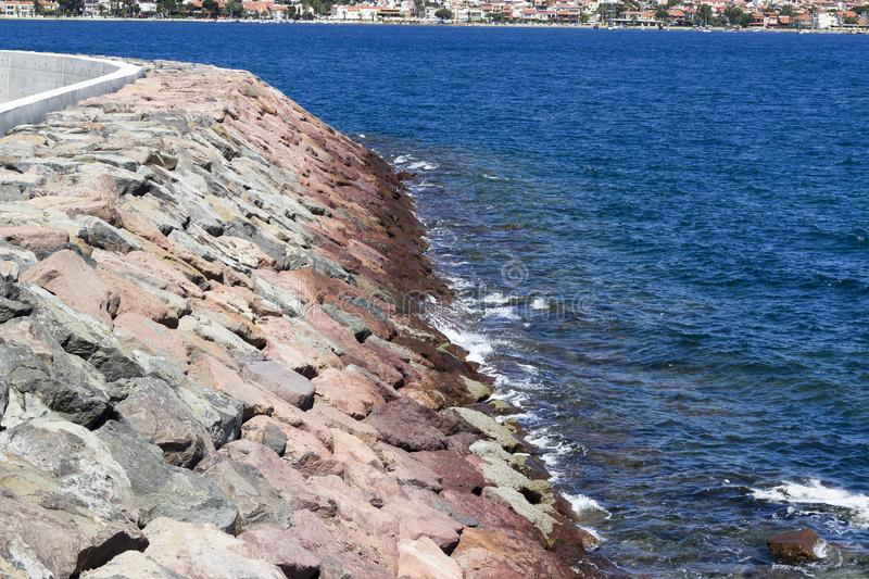 Perspective view of the rocky coastline at summertime royalty free stock images