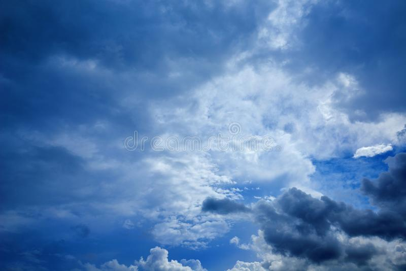 Perspective view of romantic navy blue sky with white grey clouds. Before the rain. High resolution artistic skyline background im stock photo