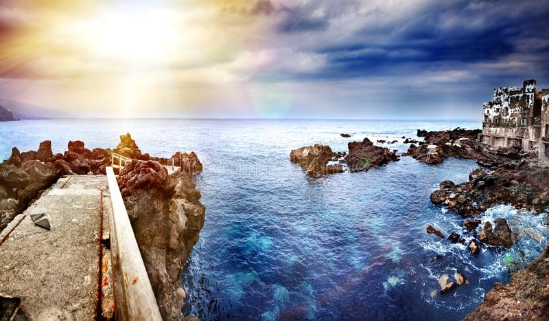 Perspective view of a stone pier in the sea. Seascape background in the ocean. Travel and vacation concept. Tenerife,. Canary Islands, Spain royalty free stock photo