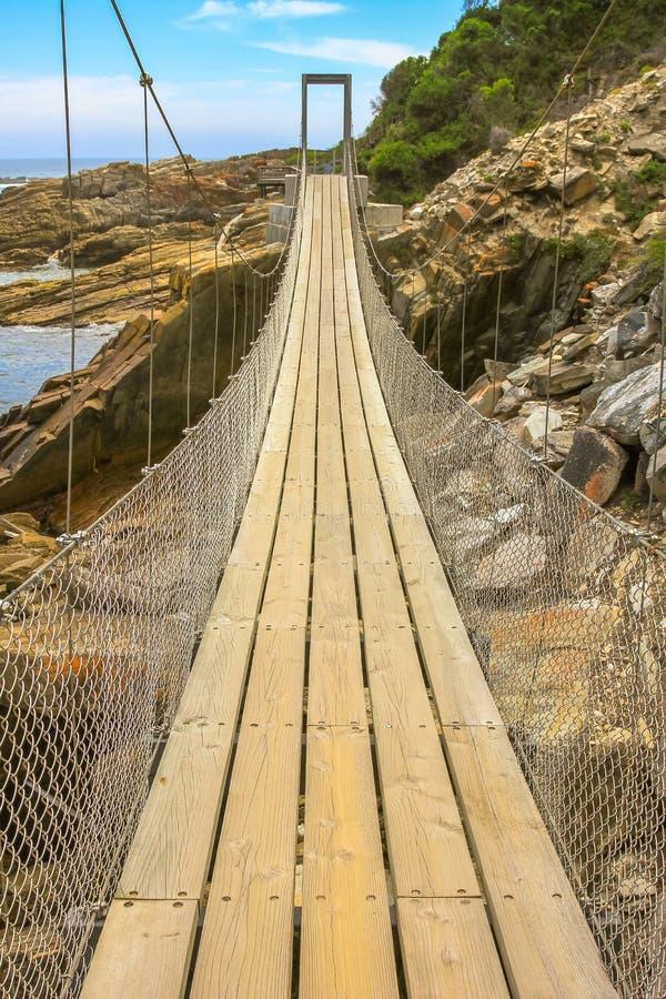 Tsitsikamma Suspension Bridge. Perspective view of Suspension Bridge over Storms River Mouth in Tsitsikamma National Park, Eastern Cape, near Plettenberg Bay in stock photo
