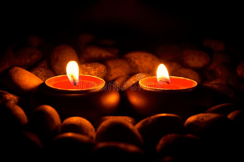 Perspective view of two burning candles royalty free stock images