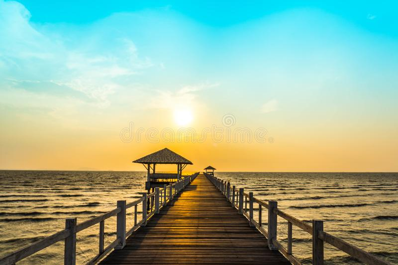 Perspective view of wooden bridge extending into the sea royalty free stock photos