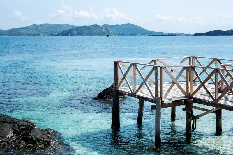 Perspective view of wooden bridge extending into the sea. holiday and summer scene stock photo