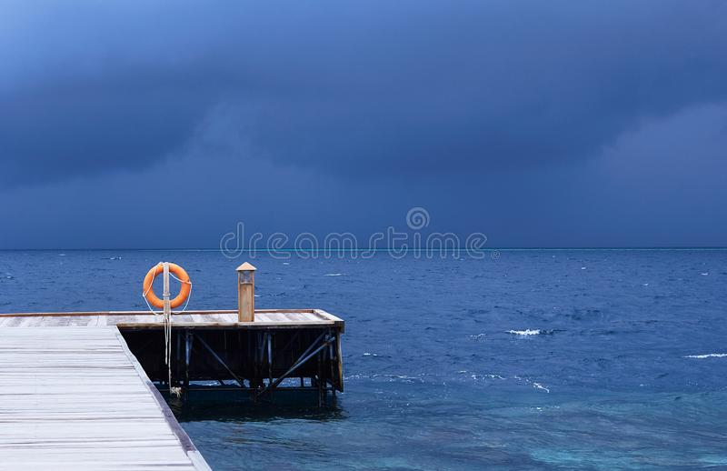 Perspective view of a wooden pier on the tropical seashore  sea with turquoise water royalty free stock image