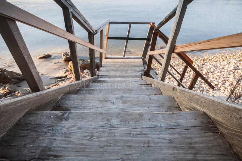 Perspective view of wooden stairs going down royalty free stock photos