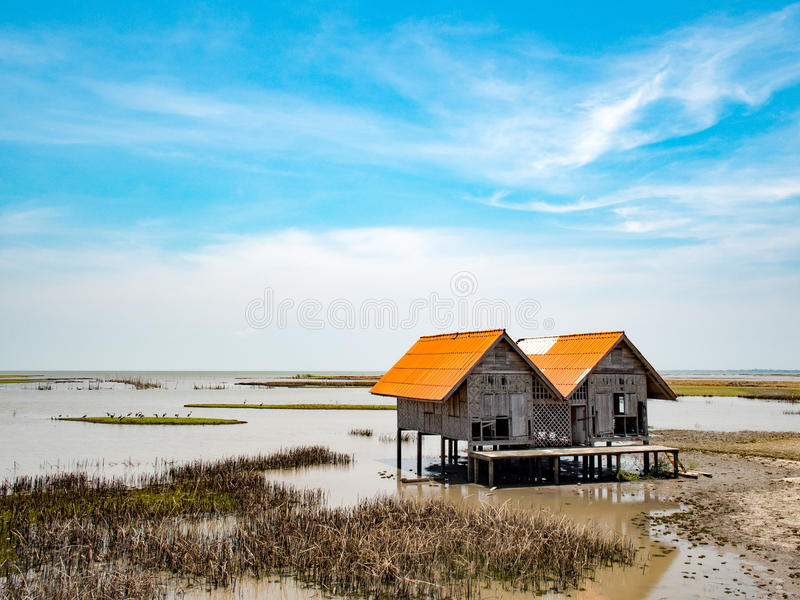 Perspective vintage local traditional old moldy hut in lake at talaynoi, Phatthalung Province, South of Thailand. Hut in the lake stock photos