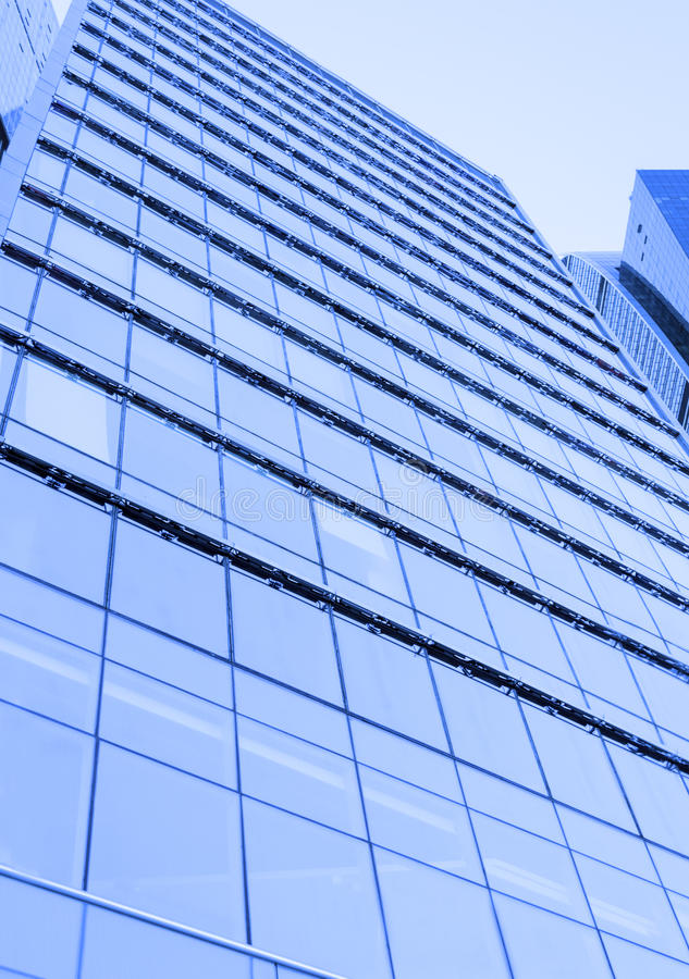 Perspective wide angle view to blue glass building skyscraper stock image