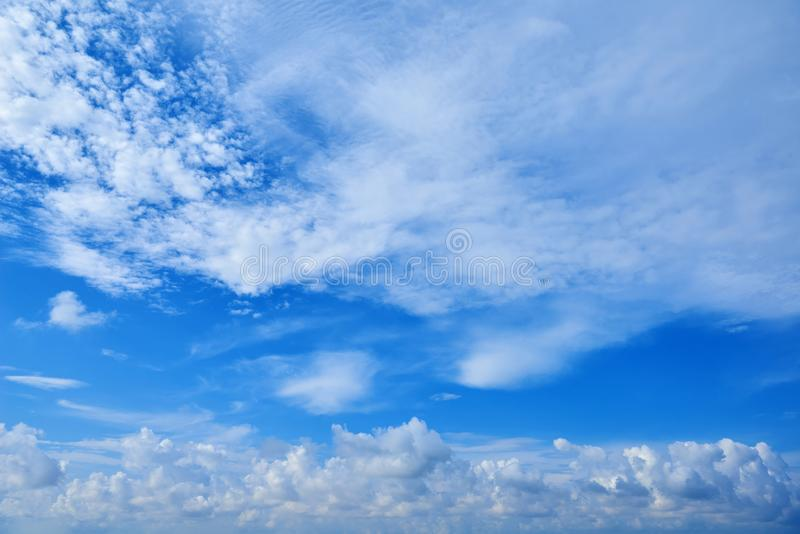 Perspective wide view of romantic navy blue sky with white grey clouds. High resolution artistic skyline background image royalty free stock images