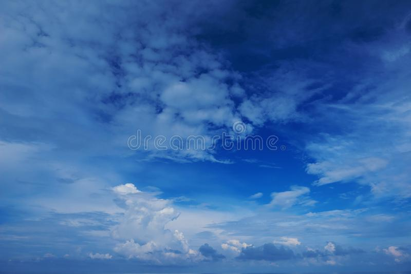 Perspective wide view of romantic navy blue sky with white grey clouds. High resolution artistic skyline background image stock photo