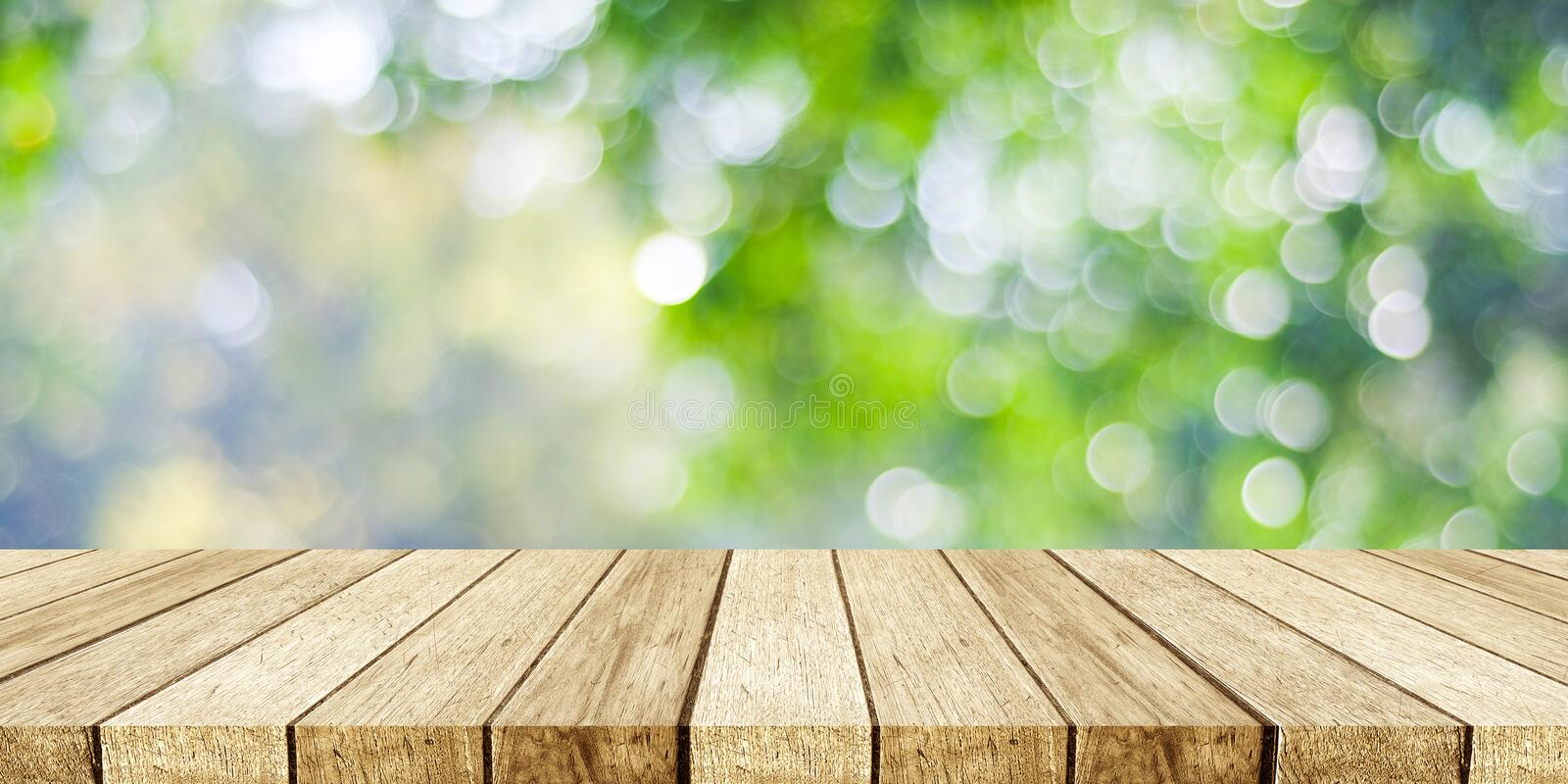 Perspective wood and blur outdoor park nature background, produc royalty free stock photo