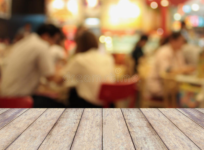 Perspective wood with blurred cafe bokeh light background, product display template stock photography