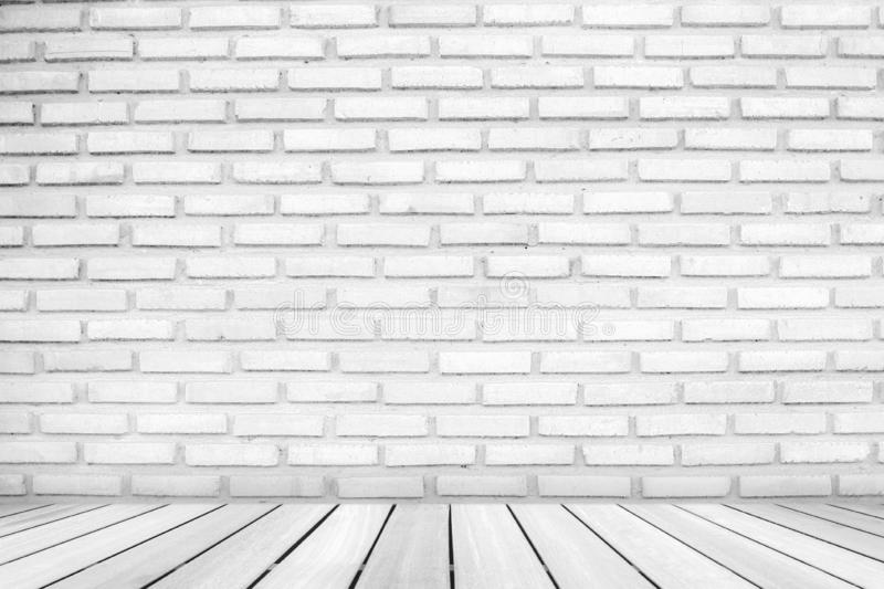 Perspective wood floor deck overlook the white vintage brick wall background . Services include product display  template royalty free stock images