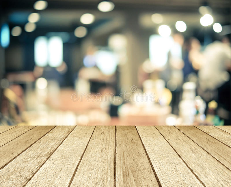 Perspective wood over blurred restaurant with bokeh background royalty free stock photography