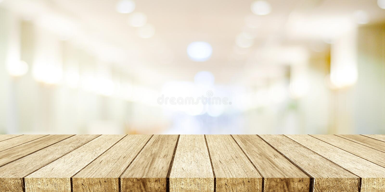 Perspective wood, table, shelf and blurred store with bokeh back. Ground, product display montage stock photography