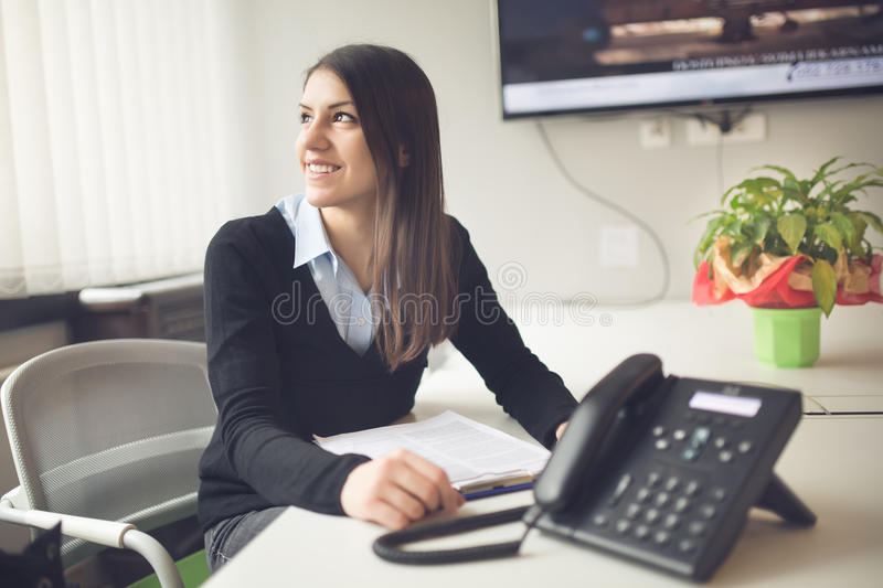 Perspective young female worker business woman day in office.Confident,smart and organized assistant.Managing business.Consultant royalty free stock image