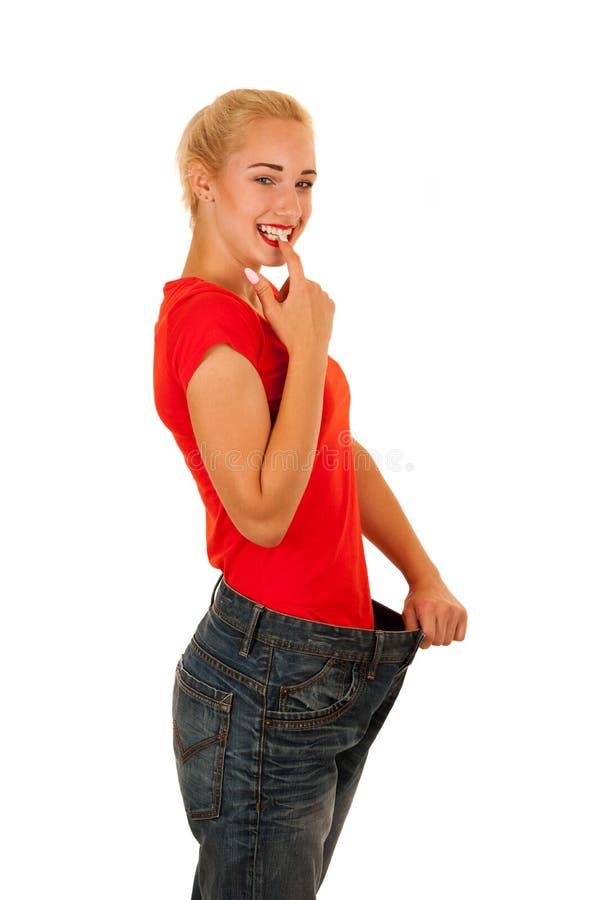 Perte de poids active de geste de jeune femme d'isolement au-dessus du backg blanc photos stock