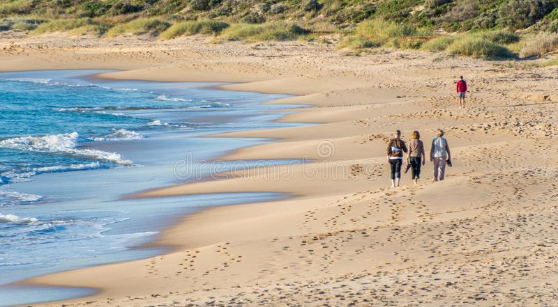 Walking along a secluded beach on a warm winters day in Perth City Western Australia stock photos