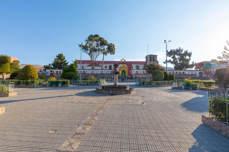 Peru Chucuito arms square at sunset royalty free stock photos