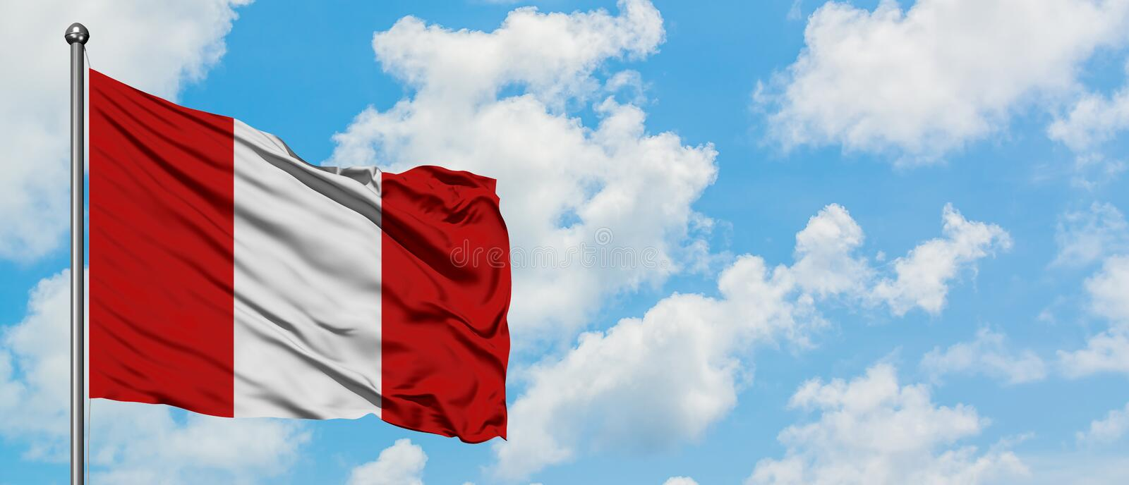 Peru flag waving in the wind against white cloudy blue sky. Diplomacy concept, international relations.  stock photography