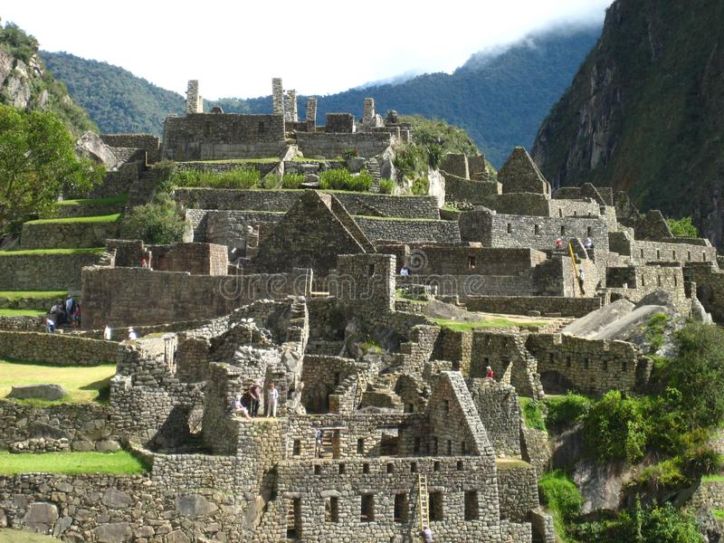 Peru: Machu Pichu, Unesco-världsarv i Andinesen royaltyfria foton