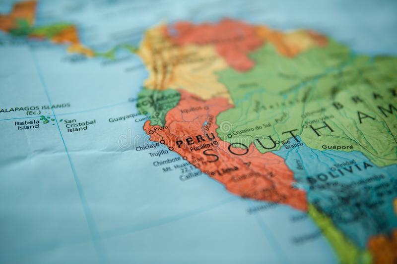 Peru on a map. Selective focus on label stock photography
