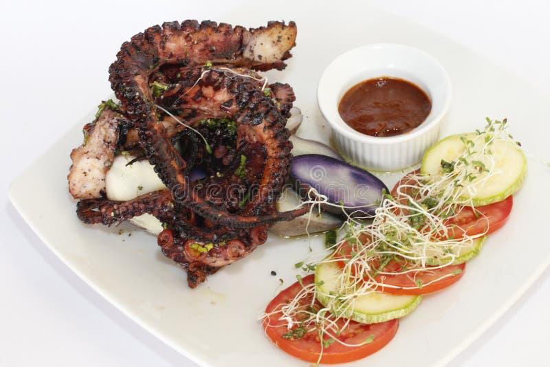PERUANSK MAT: grillad bläckfisk royaltyfri foto
